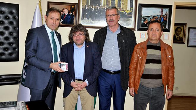 AKSED'den Karabacak'a  özel bardak hediye