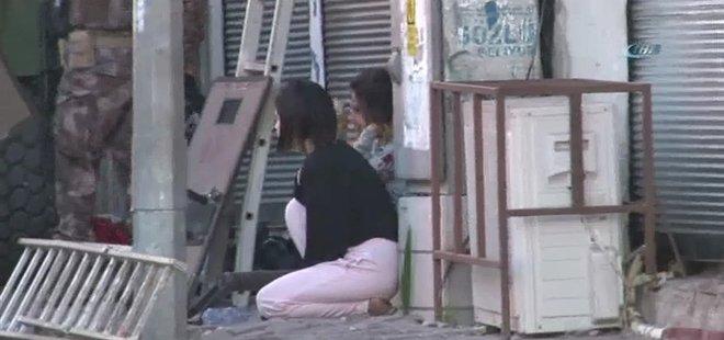 Adana'da rehine kurtarma operasyonu: Bir şahıs ablasını ve yeğenlerini silahla rehin aldı .
